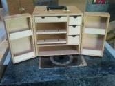 Designed to be universal. This box can hold 4 slot cars, 4 parts trays, and have room for a controller at the bottom. Made from high-grade Birch.